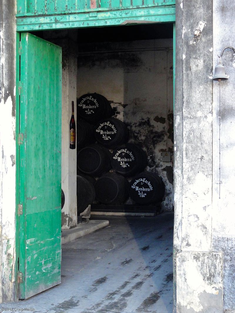 The barrels are stacked in well-ventilated cellars.