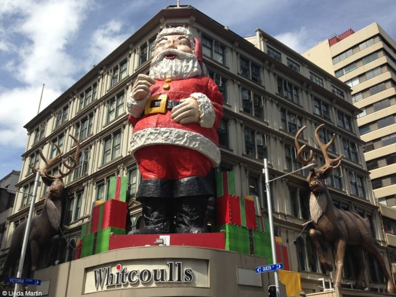 The Whitcoulls Santa -- a symbol of Christmas, summer, and childhood.