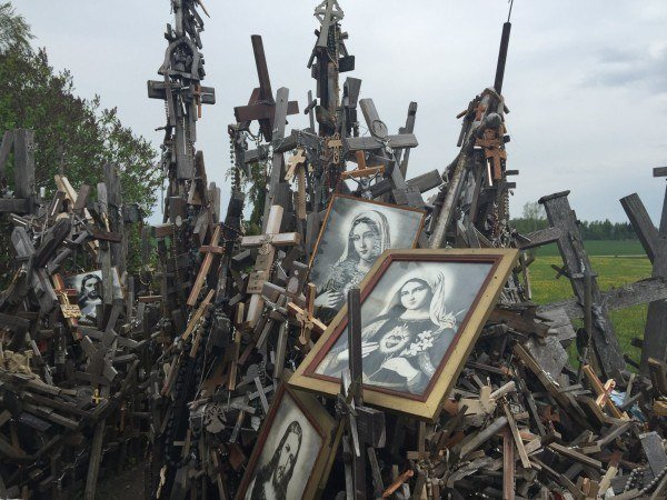 Dozens of crosses of many sizes huddle together, with a couple of pictures of the Virgin Mary amongst them.