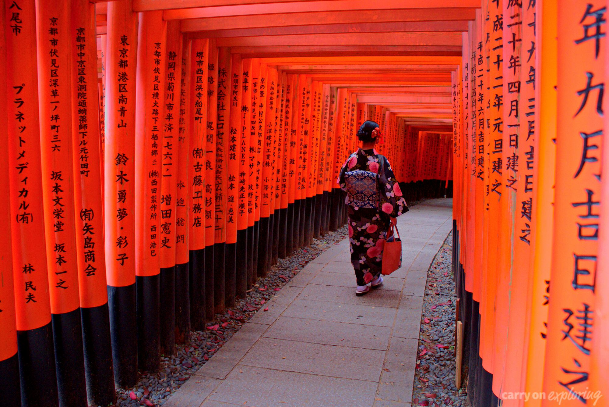 A geisha walking down a path in Kyoto, Japan.