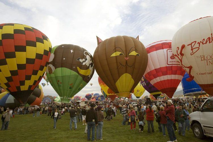 It's one of the few hot-air balloon festivals in the world where you're allowed to walk among the balloons.