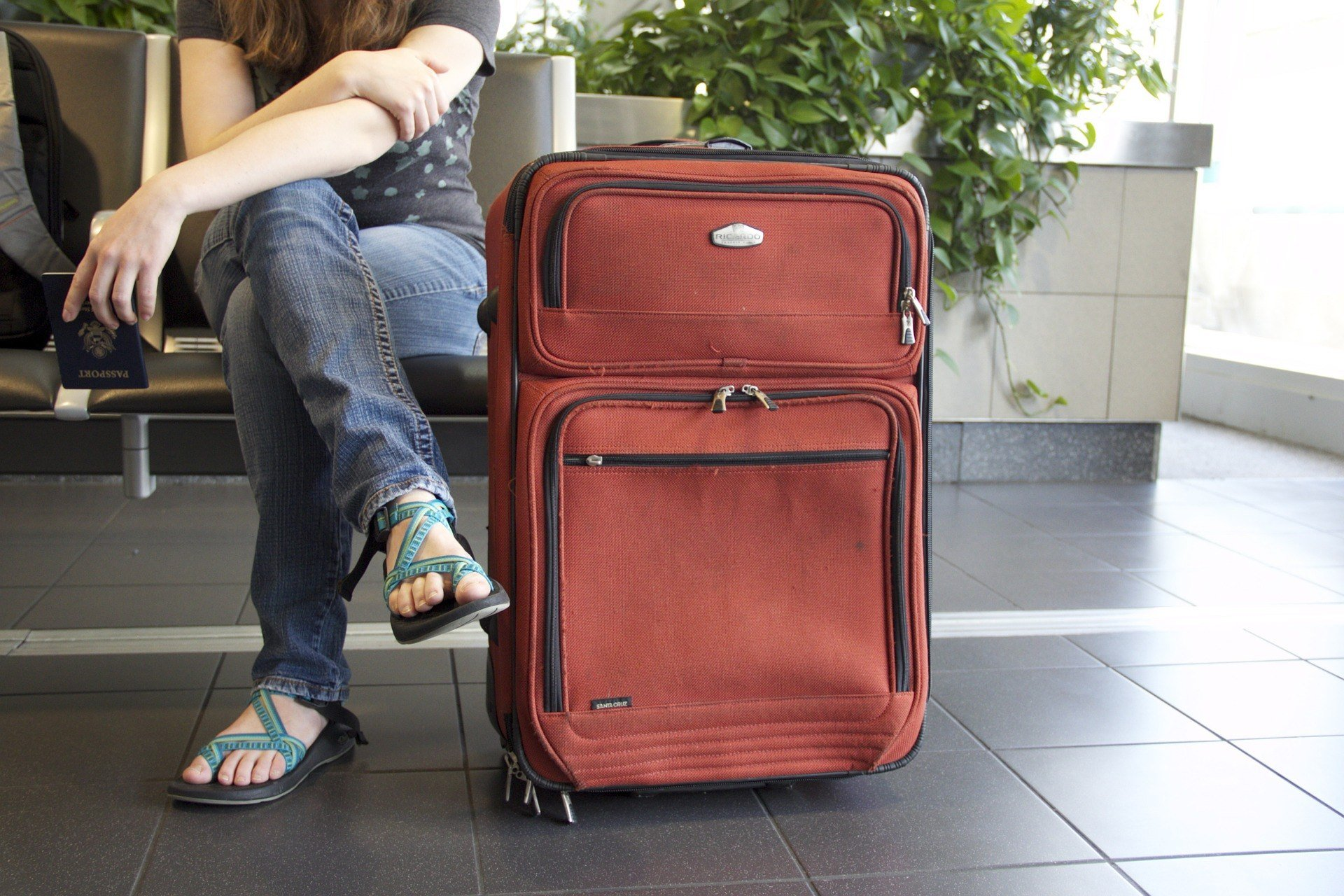 Girl and suitcase at airport