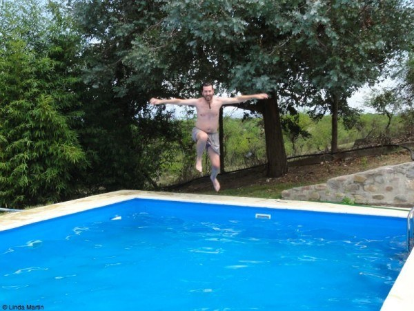 Craig jumping into the pool
