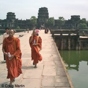 Monks and Angkor Wat in Cambodia square