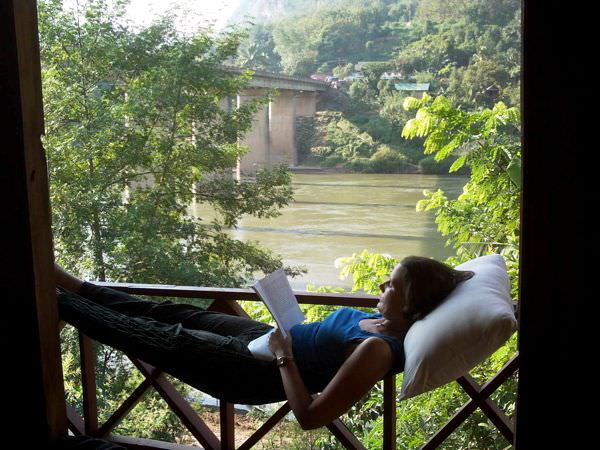 Linda relaxes at our bungalow in Nong Khiaw