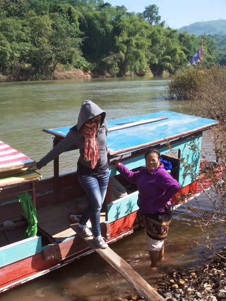 Chom takes a break from the boat in northern Laos