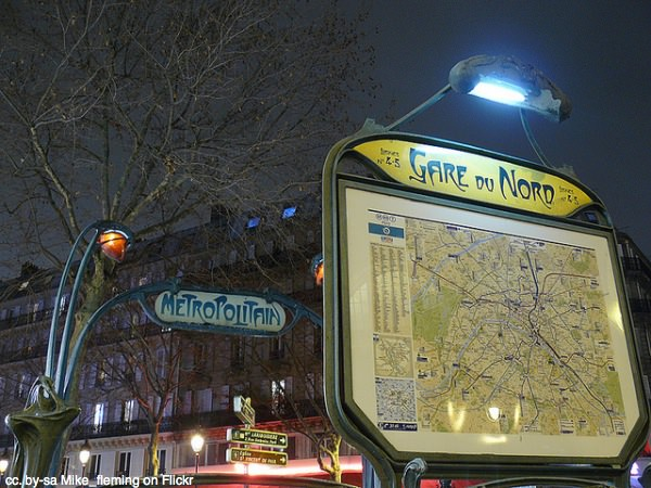 Paris metro sign night