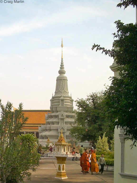 Monks and a stupa in the courtyard of the Royal Palace, Phnom Penh