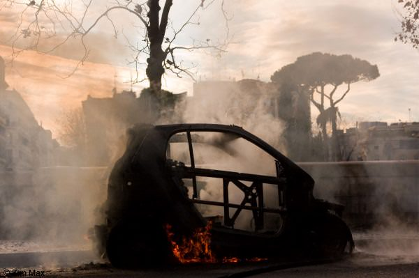 december riots in rome italy - smart car burns