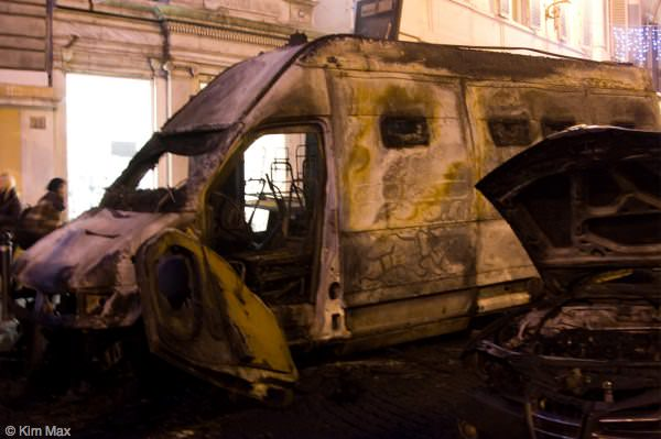 december riots in rome italy - fire damaged van