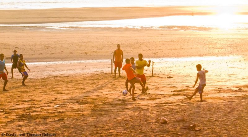 Locals playing soccer at sunset in isolated Santa Catalina, Panama