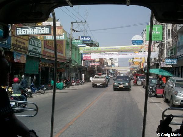 stray backpacker bus thailand laos - view from a song theau